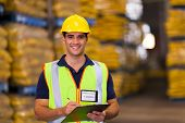 portrait of young warehouse worker indoors