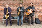 Bremen - April 27: Three Unknown Street Musicians In Bremen City Center On April 27, 2013 In Bremen,