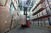 Forklift loader with pallet of sacks in distribution warehouse