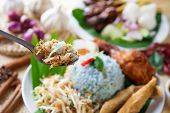 Nasi kerabu, famous Malaysian Malay rice dish. Traditional east coast blue rice. Popular in states such as Terengganu or Kelantan . Malaysia food, Asian cuisine.