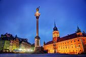Old town in Warsaw, Poland at night. The Royal Castle and Sigismund's Column called Kolumna Zygmunta