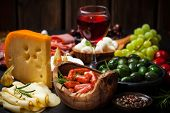picture of cheese platter  - Antipasto and catering platter with different meat and cheese products - JPG