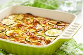 pic of green onion  - casserole with cheese and zucchini in baking dish