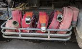 stock photo of firehose  - Firehoses and other equipment in a truck - JPG