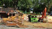 Destroyed truck and excavators