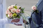 Wedding Bouquet Of Roses And The Groom's Boutonniere