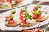 Mediterranean style canape with feta cheese and tomato