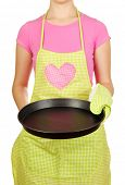 stock photo of homemaker  - Closeup of  homemaker in apron  holding  pan isolated on white - JPG