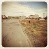 stock photo of girl walking away  - Young Girl walking away  - JPG
