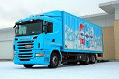 Turquoise Scania R500 Delivering Goods To A Store