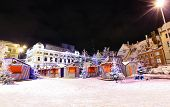 stock photo of drama  - Livu square with Christmas market in a heart of Old Riga Latvia at night with Russian Theater of Drama in a background - JPG
