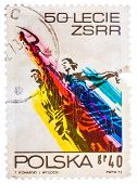 Stamp Printed In The Poland Shows Man And Woman, Sculpture By Wiera Muchina, 50Th Anniversary Of The