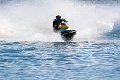 picture of jet-ski  - High speed jet ski on waves with splashes - JPG