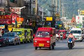PHUKET, THAILAND JANUARY 1 : Tuk-tuk moto taxi on the street on January 1, 2014 in Phuket, Thailand.