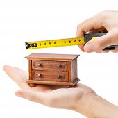 Woodworker Measuring Chest Of Drawers With A Tape Measure, Carpentry Concept