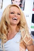 Pamela Anderson at the PETA Goes Postal Postage Stamp Unveiling, Hollywood Post Office, Hollywood, CA 11-29-11