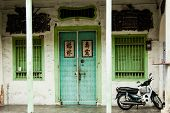 GEORGE TOWN, PENANG, MALAYSIA - SEPTEMEBER 4, 2013: Old painted Chinese shophouse facade