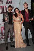 Dave Haywood, Hillary Scott and Charles Kelley of Lady Antebellum at the 2011 CMA Awards, Bridgeston