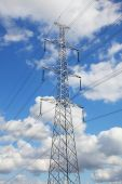 stock photo of nonrenewable  - antenna lost in the blue of the sky - JPG