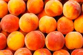 stock photo of fruit  - Peach Close Up Fruit Background Stock Photo - JPG