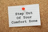image of self-confident  - The phrase Step Out of Your Comfort Zone on a paper note pinned to a cork notice board - JPG