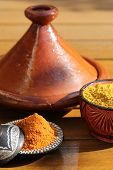 image of tagine  - Tagine with containers with spices in the sun - JPG