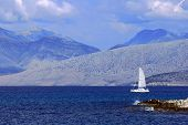 picture of off-shore  - Sailboat off the shore of Albania and mountains