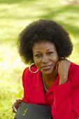 Outdoor Portrait Older Black Woman Red Jacket
