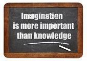 Imagination is more important than knowledge - a quote from Albert EInstein -  white chalk text  on a vintage slate blackboard