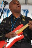 image of stratocaster  - Blues guitar player showing lots of emotion while playing - JPG
