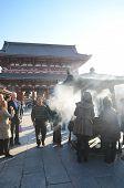 Tokyo, Japan - November 21: Buddhists Gather Around A Fire To Light Incense And Pray At Sensoji Temp