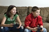 Sister And Brother Playing A Video Game