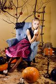 blond cute girl in halloween interior