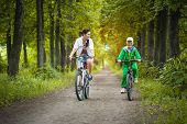 Mother and son riding bicycle in the park