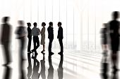 Composite image of business colleagues talking against white room with large window overlooking city