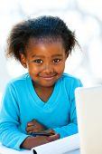 Cute African Student Doing Homework.