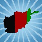 Afghan map flag on blue sunburst illustration