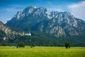 Neuschwanstein castle with mountains on the background. Germany