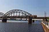 Train On The Bridge Over Daugava River. Riga, Latvia