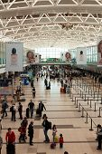 BUENOS AIRES, ARGENTINA - MAR 21 2014 : Passengers await checkin at Ezeiza Airport