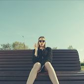 foto of teen smoking  - Young hipster woman smoking in park - JPG