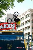 Young Man Practices Bicycle Flips Before Bmx Competition
