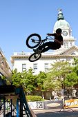 Teenage Boy Practices Ramp Jumps At Bmx Competition