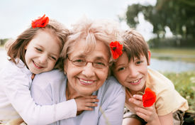 picture of grandmother  - Closeup summer portrait of happy grandmother with grandchildren outdoors - JPG