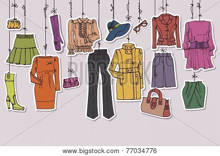 Постер, плакат: Womans clothing and accessories hanging on ropes, холст на подрамнике