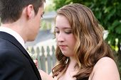 Nervous Prom Girl Fixing Boutonniere