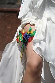 stock photo of garter  - Floral wedding garter on leg of bride  - JPG