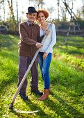 picture of scythe  - Old farmer with scythe having a break from work and his daughter - JPG