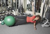 pic of black curly hair  - African American woman working out with a gym ball - JPG