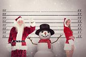 Jolly Santa waving at camera against mug shot background